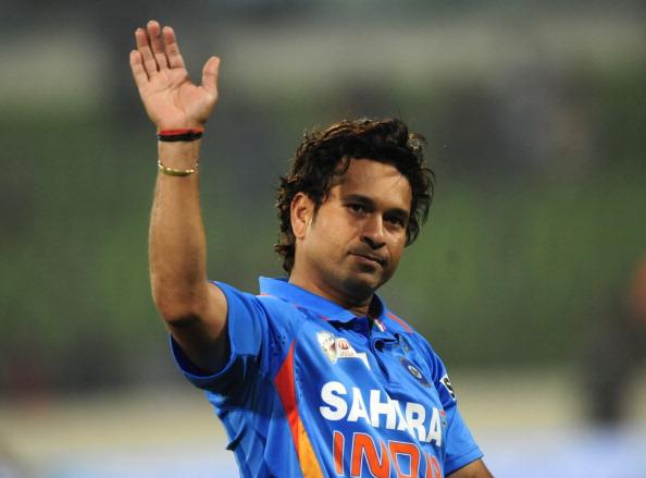 Indian cricketer Sachin Tendulkar gestur