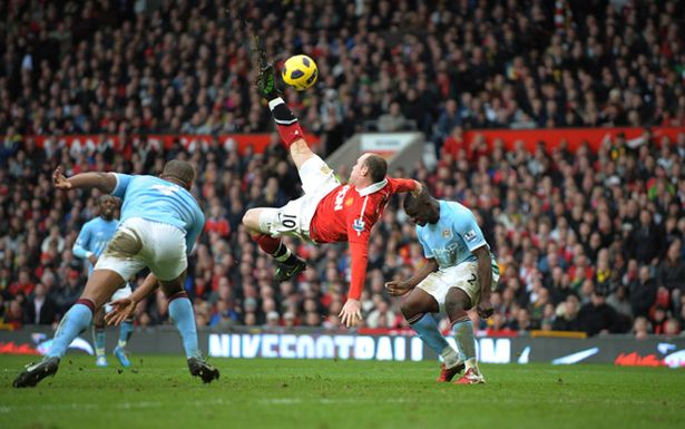 Robin Parker, FotoSports- Wayne Rooney scores an overhead kick against Manchester City