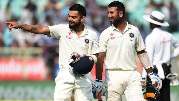 Kohli-L-talks-with-Pujara-as-they-walk-back-to-pavillion-for-tea-break-during-the-first-day-of-the-2nd-Test-between-India-and-England3