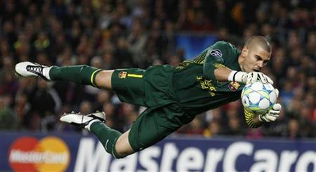 Barcelona's goalkeeper Valdes makes a save during their Champions League soccer semi-final against Chelsea in Barcelona